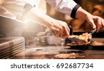 hand of man take cooking of... | Shutterstock . vector #692687734