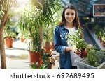 young girl shopping for plants... | Shutterstock . vector #692689495