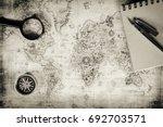 an ancient map  a compass and a ... | Shutterstock . vector #692703571