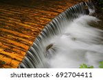 nice view on cascade of small... | Shutterstock . vector #692704411
