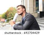 handsome male business... | Shutterstock . vector #692704429