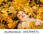 little child having fun lying... | Shutterstock . vector #692709571