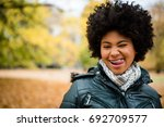 teenage girl winking and... | Shutterstock . vector #692709577
