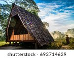 a thatch hut and a view of... | Shutterstock . vector #692714629