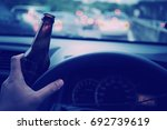 man drink beer while driving... | Shutterstock . vector #692739619