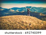 hiker with backpack standing on ... | Shutterstock . vector #692740399