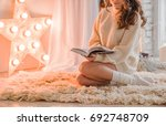 woman with book | Shutterstock . vector #692748709
