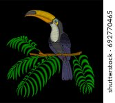 embroidery toucan bird sitting... | Shutterstock .eps vector #692770465