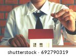 asian salesman holding key and... | Shutterstock . vector #692790319