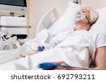 Small photo of Weak ailing woman getting oxygen for recovery