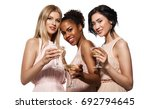 three young smiling women ... | Shutterstock . vector #692794645