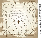 doodle arrows and symbols on... | Shutterstock .eps vector #692797501