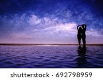 silhouette of couple love on... | Shutterstock . vector #692798959