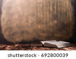 bible and the crucifix on a... | Shutterstock . vector #692800039