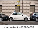 ROME - SEPTEMBER 8, 2013: Cars are parked on the street very tightly to each other. A common way of parking in large European cities. - stock photo