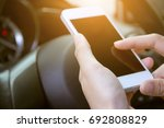 hands holding smart phone...   Shutterstock . vector #692808829