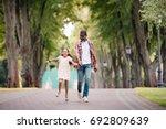 happy african american... | Shutterstock . vector #692809639