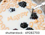The words HAPPY spelled out of letter shaped cereal pieces floating in a milk filled cereal bowl. - stock photo