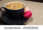 cup of coffee with pink peach... | Shutterstock . vector #692828401