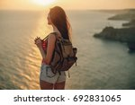 the woman is traveling | Shutterstock . vector #692831065