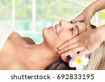 beautiful blond woman lying...   Shutterstock . vector #692833195