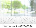 empty wooden table with party... | Shutterstock . vector #692840554