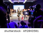 televison camera broadcasting a ... | Shutterstock . vector #692843581