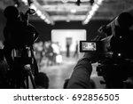 televison camera broadcasting a ... | Shutterstock . vector #692856505