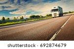 asphalt road on dandelion field ... | Shutterstock . vector #692874679