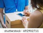 asian woman appending signature ... | Shutterstock . vector #692902711