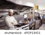 thoughtful chef standing in... | Shutterstock . vector #692913421