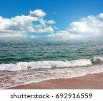 beautiful sandy beach and... | Shutterstock . vector #692916559
