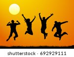 jumping people at sunset ... | Shutterstock .eps vector #692929111