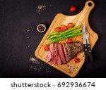juicy steak rare beef with... | Shutterstock . vector #692936674