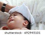 1 year asian baby boy get sick... | Shutterstock . vector #692945101
