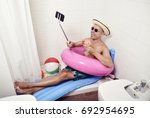 a young caucasian man wearing... | Shutterstock . vector #692954695