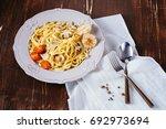 creamy italian pasta with... | Shutterstock . vector #692973694