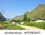houses in the valley in... | Shutterstock . vector #692985697