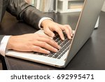 human officer sit on chair use... | Shutterstock . vector #692995471