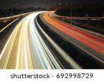 light trails in a highway of... | Shutterstock . vector #692998729