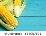 ripe yellow sweet corn cob on a ... | Shutterstock . vector #693007531
