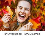 portrait of happy young woman... | Shutterstock . vector #693033985