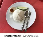 Small photo of White rice, cucumber and salt egg served on plate. This menu is serve with Malay food called Asam Pedas