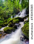 nature landscape of waterfall... | Shutterstock . vector #693045085