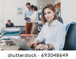 young woman working on laptop... | Shutterstock . vector #693048649