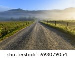 Gravel Road In Mountain Valley...