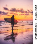 Silhouette Of Surfer Girl With...