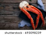 fresh crab claws on black tray... | Shutterstock . vector #693098239
