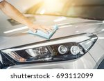 car detailing   the man holds... | Shutterstock . vector #693112099