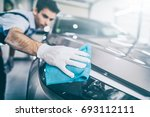 car detailing   the man holds... | Shutterstock . vector #693112111